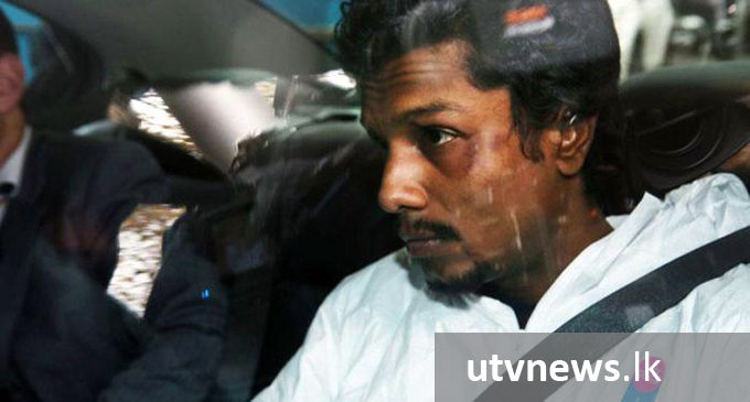 Jail term reduced for Lankan who made threats on a plane with a fake bomb