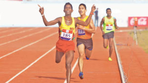 Kumar Shanmugeshwara takes the silver in the men's 10,000 metres.