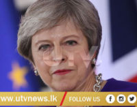 Theresa May survives no-confidence vote in British Parliament
